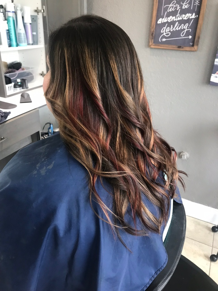 curled caramel and cherry hair from right