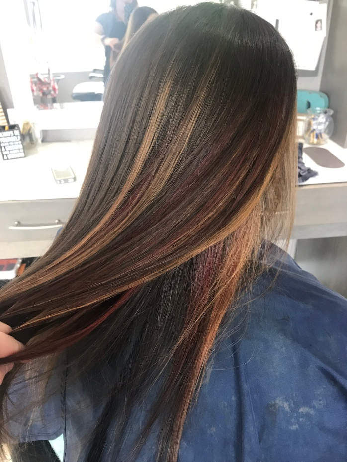fanned caramel and cherry hair