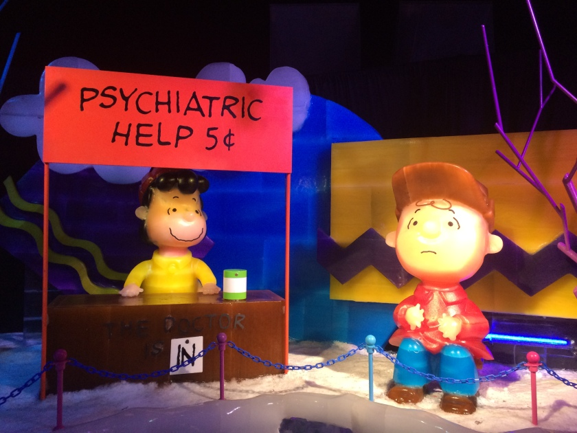 Charlie talking to Lucy at Psych booth