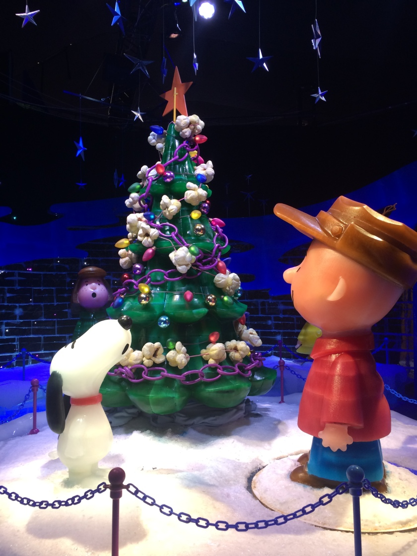 Snoopy and Charlie Brown singing with tree at end of movie