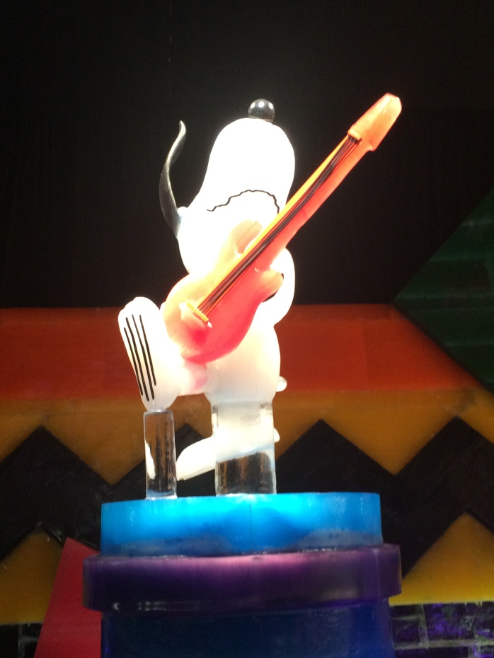 Snoopy playing guitar at rehearsal